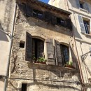 Pretty balcony with shutters in Arles