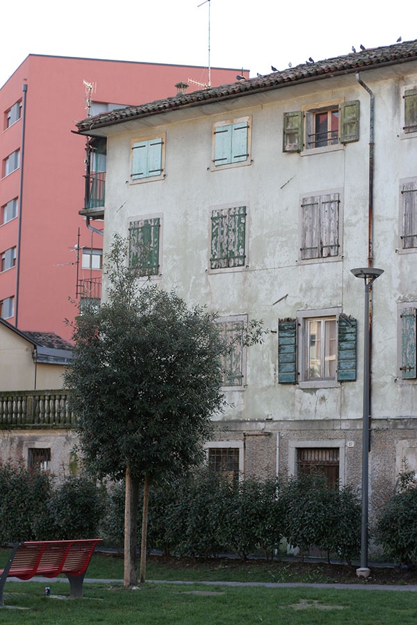 Old building overlooking Udine park around the corner